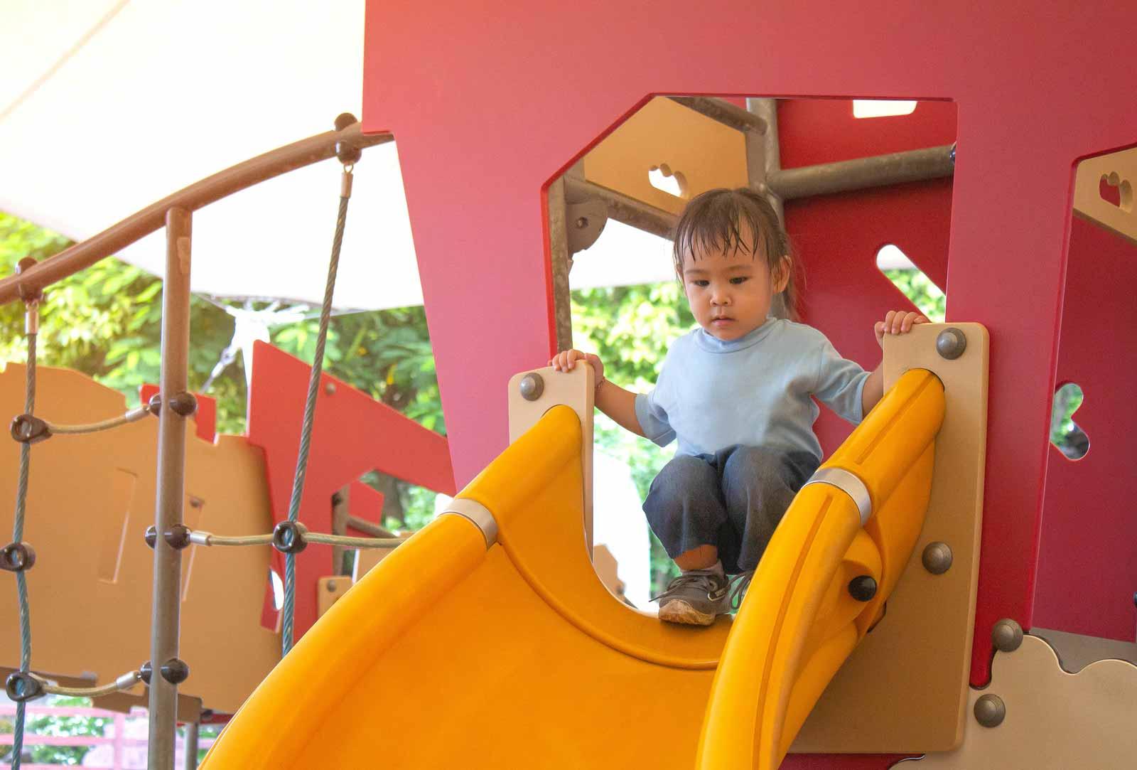 Risk in Play - Girl Sliding